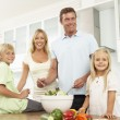 Family Preparing Salad In — Stock Photo #4838731