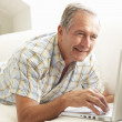 Senior Man Using Laptop — Stock Photo #4838763