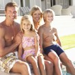 Family Outside Relaxing By — Stock Photo #4838786