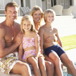 Stock Photo: Family Outside Relaxing By