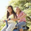 Stock Photo: Girls Riding On See Saw