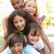 Five young friends piled on — Foto Stock