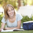 Female Teenage Student Studying In Park — Stock Photo #4838882