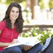 Female Teenage Student Studying In Park — Stock Photo #4838910