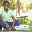 Male Teenage Student Studying In Park — Foto Stock