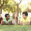 Group Of Teenagers Lying On Stomachs In Park — Stock Photo #4838926