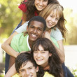 Group Of Teenagers Piled Up In Park - Stock Photo