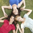 Group Of Teenager Girls Looking Up Into Camera — Stock Photo