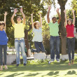 Group Of Teenagers Jumping In Air In Park — Stock Photo