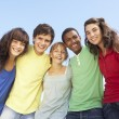 Group Of Teenage Friends Standing Outside - Foto Stock