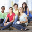Group Of Teenage Friends Sitting On College Steps Outside — Stock Photo #4838947