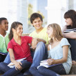 Group Of Teenage Friends Sitting On College Steps Outside — Stock Photo #4838948