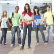 Group Of Teenage Students Standing Outside College Building — Stock Photo #4838968