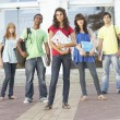 Group Of Teenage Students Standing Outside College Building — Stock Photo