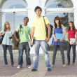 Group Of Teenage Students Standing Outside College Building — ストック写真