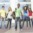 Royalty-Free Stock Photo: Group Of Teenage Students Standing Outside College Building