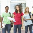 Stock Photo: Group Of Teenage Students Standing Outside College Building