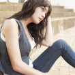 Unhappy Female Teenage Student Sitting Outside On College Steps — Stock Photo #4838996