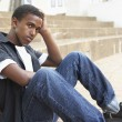 Unhappy Male Teenage Student Sitting Outside On College Steps — Stock Photo