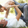 Father And Son Playing Together In Park — Stock Photo