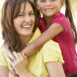 Portrait Of Mother And Daughter Together In Park — Stockfoto