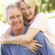 Stock Photo: Portrait Of Romantic Senior Couple In Park