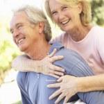 Portrait Of Romantic Senior Couple In Park — Stock Photo