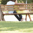 Couple Sitting Together On Park Bench — Stock Photo #4839131