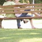 Senior Couple Sitting Together On Park Bench — Stock Photo #4839132