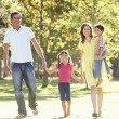 Family Enjoying Walk In Park — Stock Photo #4839137