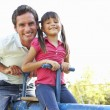 Father And Daughter Riding On See Saw In Playground — Stock Photo