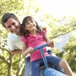 Father And Daughter Riding On See Saw In Playground — Stock Photo #4839143