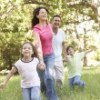 Family Enjoying Walk - Stock Photo