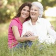 Senior Woman With Adult - Stock Photo