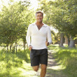 Middle Aged Man Jogging In Park — Stock Photo