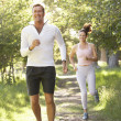 Royalty-Free Stock Photo: Middle Aged Couple Jogging In Park