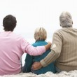 Grandfather, Father And Grandson Sitting On Winter Beach — Stock Photo