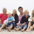 Three Generation Family Sitting On Winter Beach Together — Stock Photo