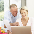 Couple Using Laptop At Home — Stock Photo #4839639