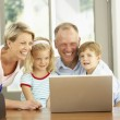 Family Using Laptop At Home — Stock Photo #4839718