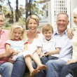 Stock Photo: Extended Family Relaxing In Garden