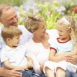 Stock Photo: Family Relaxing In Garden