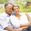 Couple Relaxing In Garden — Stock Photo #4839961