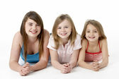 Three Girls Piled Up In Pyramid In Studio — Stock Photo