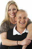 Studio Portrait Of Young Couple Hugging — Foto Stock