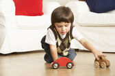 Young Boy Playing With Toy Cars At Home — Stock Photo