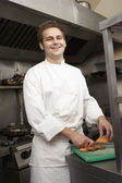 Male Chef Preparing Vegetables In Restaurant Kitchen — Stock Photo