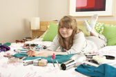 Teenage Girl In Untidy Bedroom Painting Nails — Stock Photo