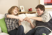 Teenage Couple Arguing Over TV Remote — Stock Photo