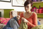 Young Woman Sitting In Chair Knitting — Stockfoto